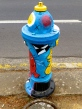 all the fire hydrants in Eugene are painted with different colorful designs