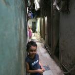 Boy in a narrow street in Dharavi