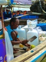 ::making us a fresh coconut shake on the boat::
