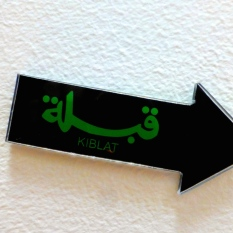 ::the hotel had arrows pointing towards Mecca for Muslim prayer::