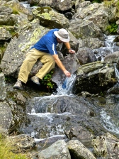 ::look at my resourceful man, refilling our water from the creek::